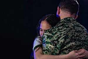 Woman hugs soldier returning from combat