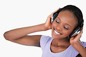 smiling happy dreamy girl listing on headphones