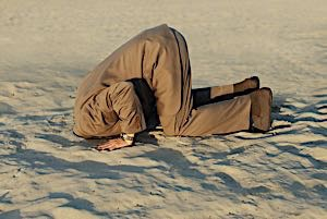 man with his head in the sand evading the issue
