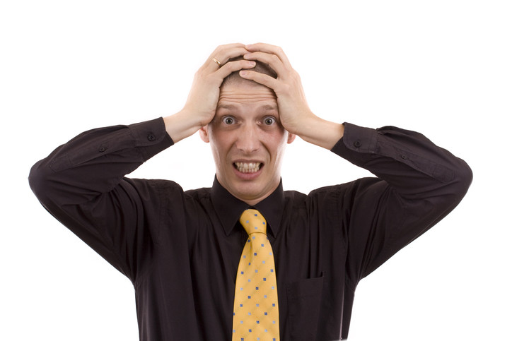 puzzled exasperated upset man grasping head