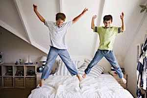 Parenting ADHD boys jumping on bed