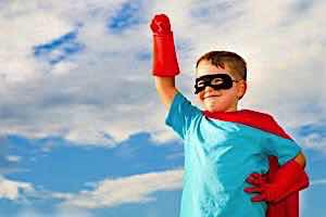 parent lets child show independence by wearing a superhero costume