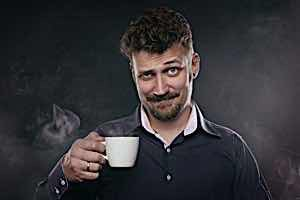 sleazy boastful man holding cup of coffee