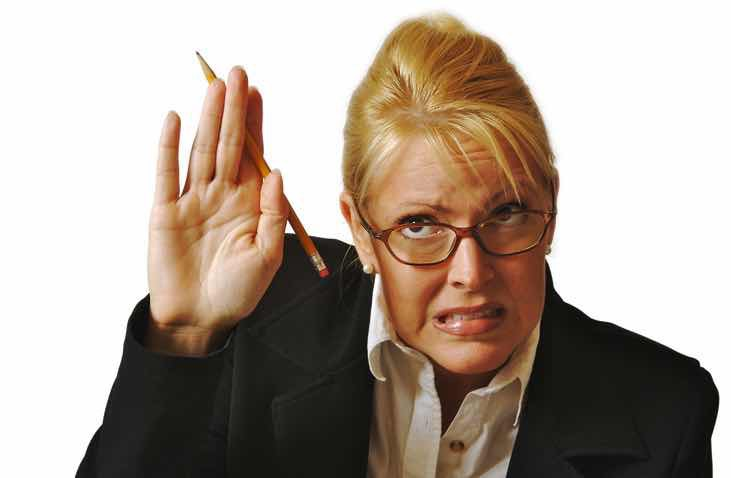 woman in office indicating stop leave me alone