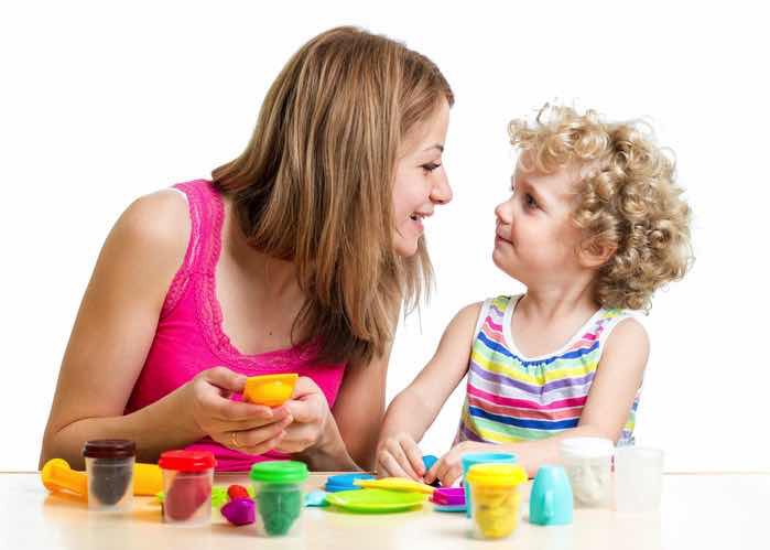 smiling child and single mother playing