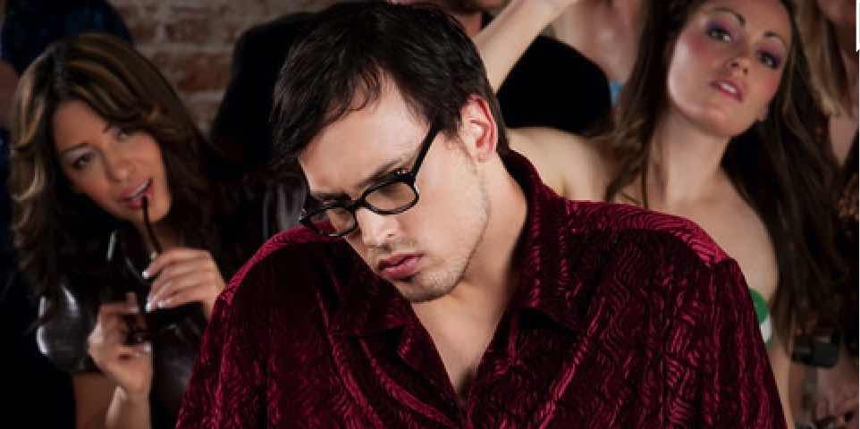 shy unpopular guy at party with girls in background